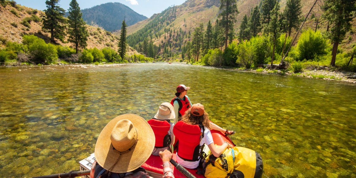 A ROW Adventures Stern Mount Oar Raft floats through a gentle section on the Middle Fork of the Salmon River