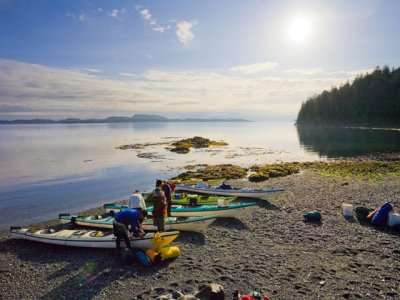 Loading kayaks on the beach in British Columbia