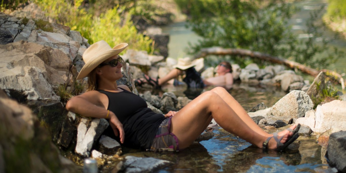 woman lounging in the river
