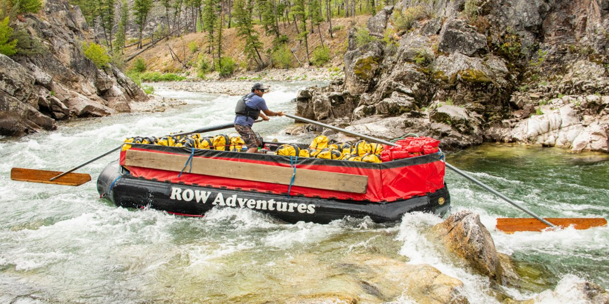 ROW Adventures Guide expertly guides the sweep boat down the Salmon river