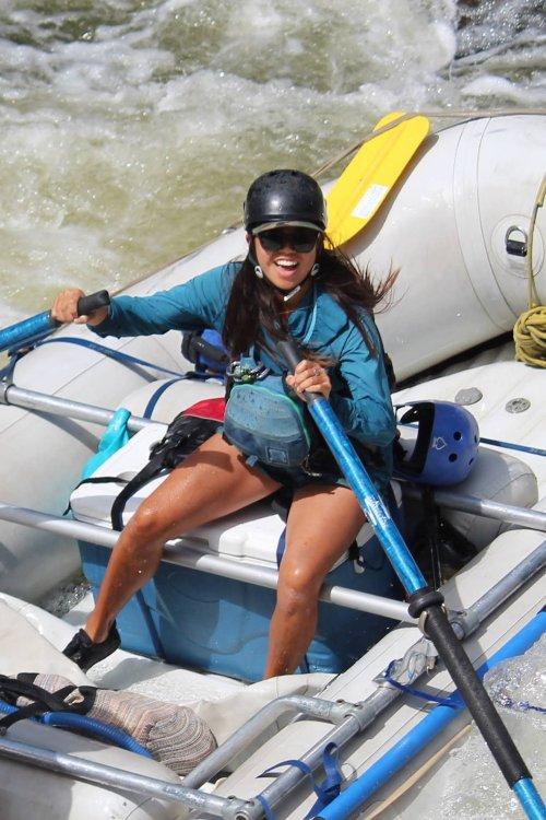 Idaho river guide rowing a raft