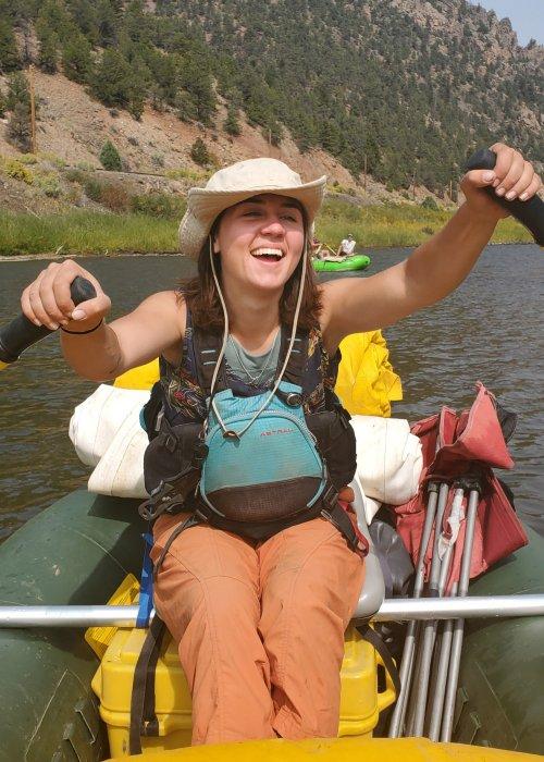 girl holding oars on river raft
