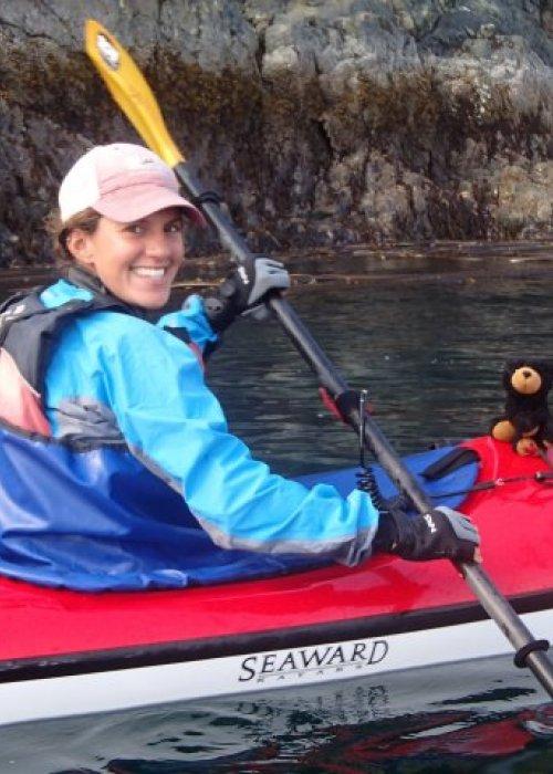 female sea kayak guide