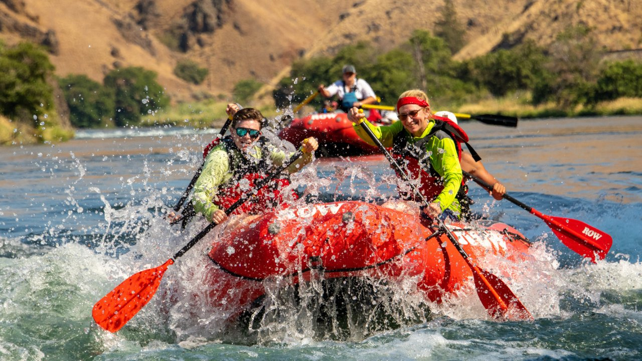 red whitewater raft on river