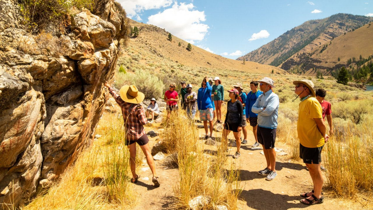 people looking at rock art along the salmon river in Idaho