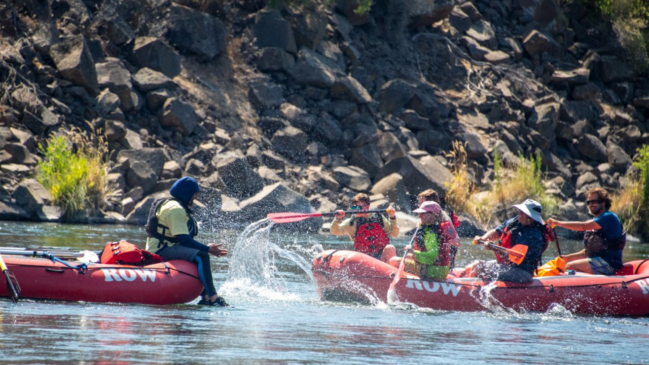 two rafts in a fun water fight on the Deschutes river