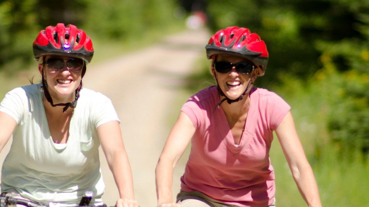 women on bicycle tour in idaho