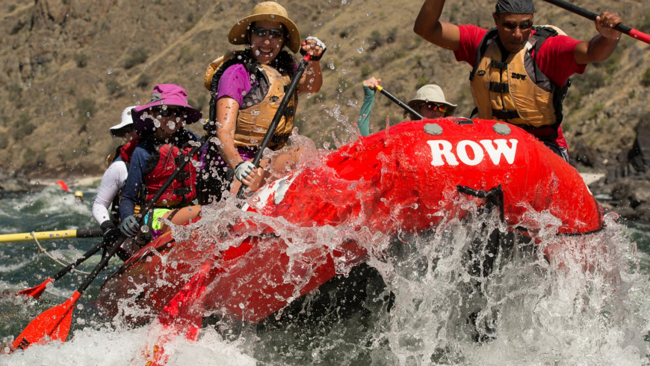 raft with people paddling on the deschutes river in oregon