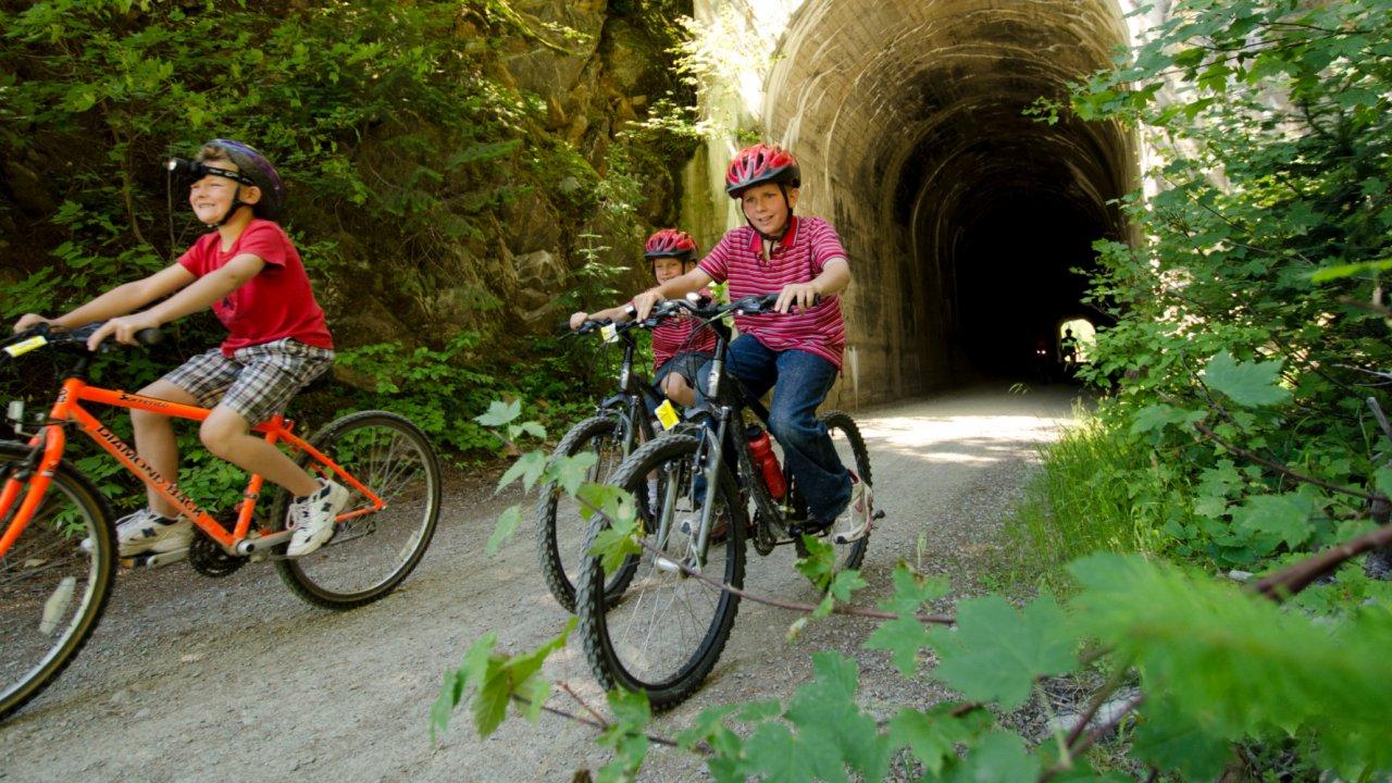 kids riding bikes on hiawatha trail in Idaho