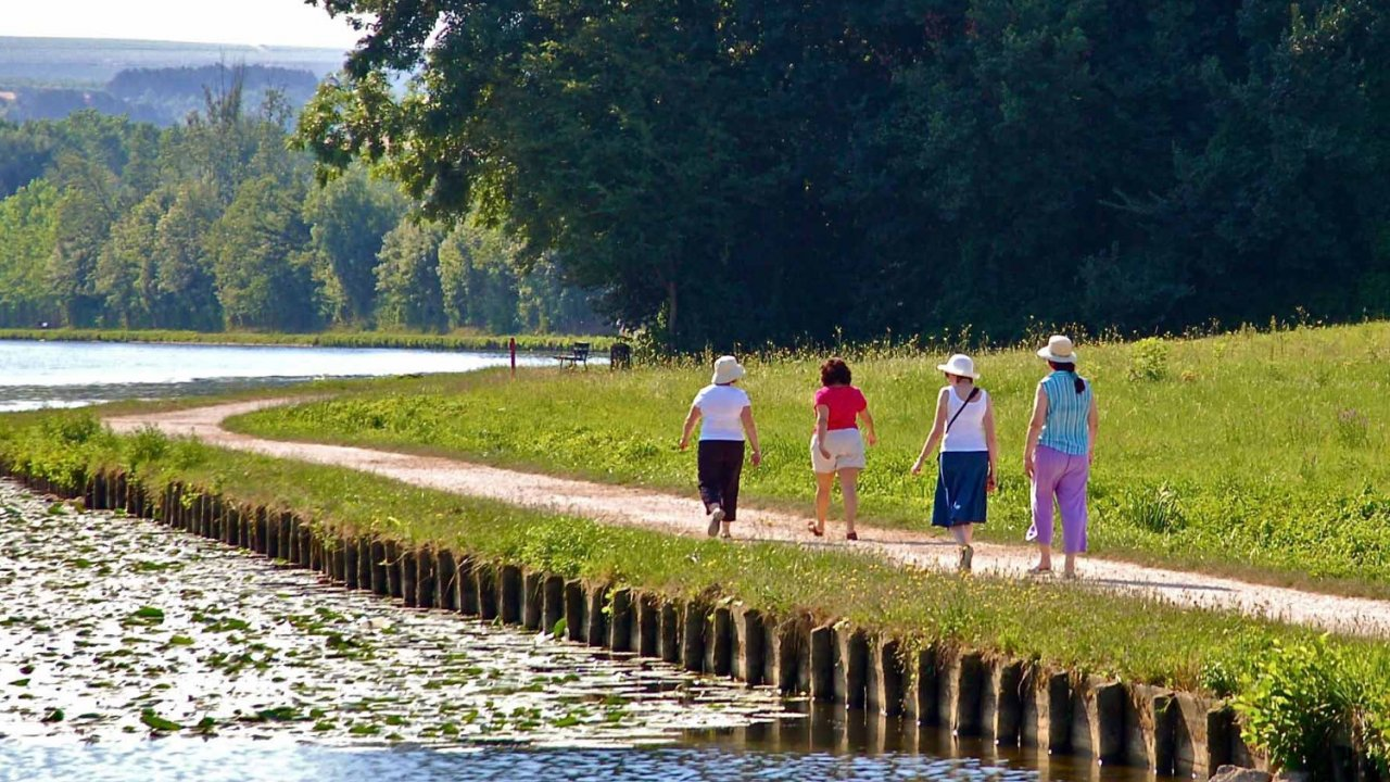 people walking along french canal