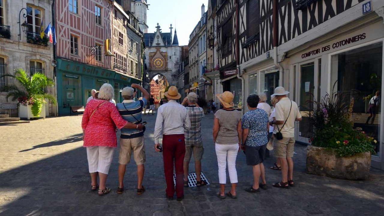 people on walking tour of french city