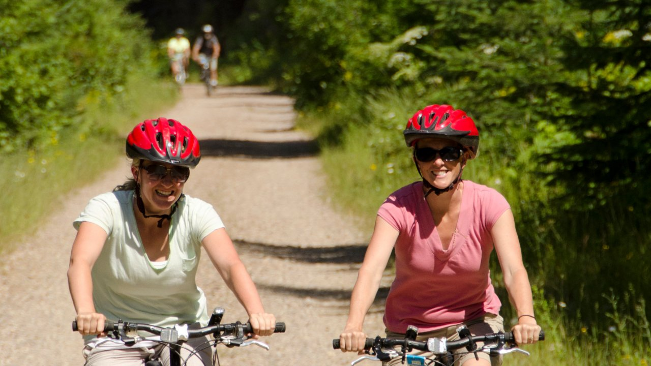 women biking in idaho