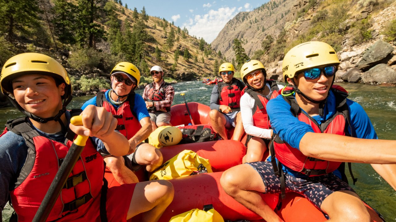 group of people on whitewater raft