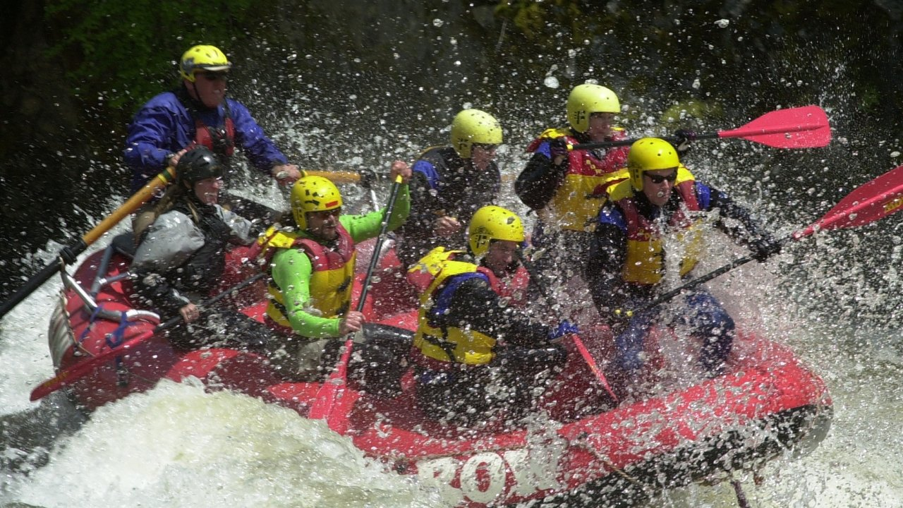 whitewater raft with people in splashy water