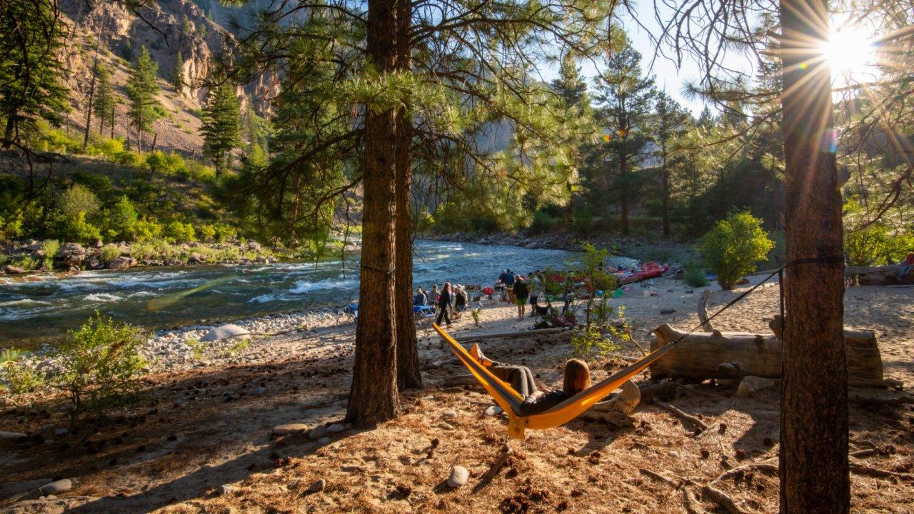girl in hammock at rafting camp on salmon river