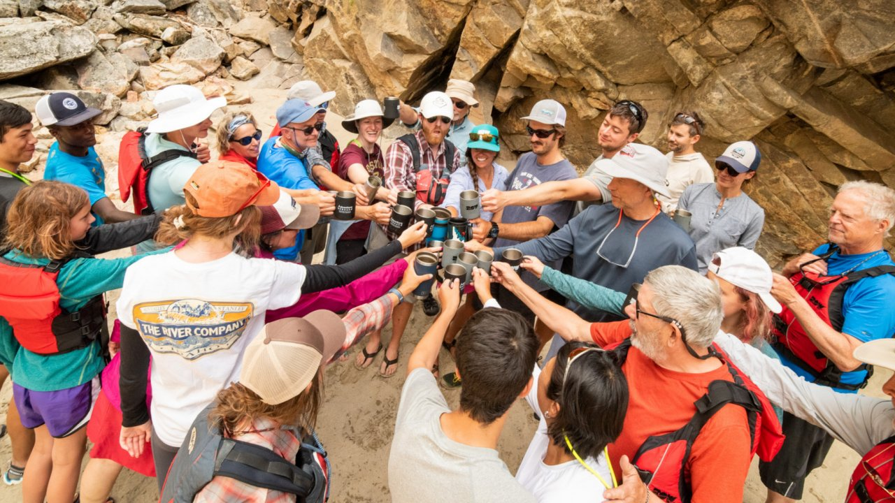 rafting group toasting along the river