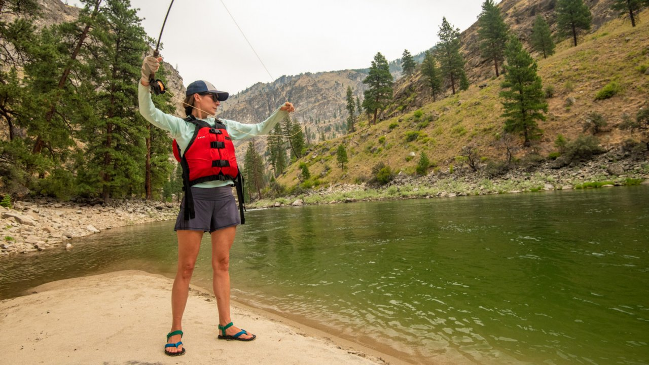 woman fly fishing along the salmon river