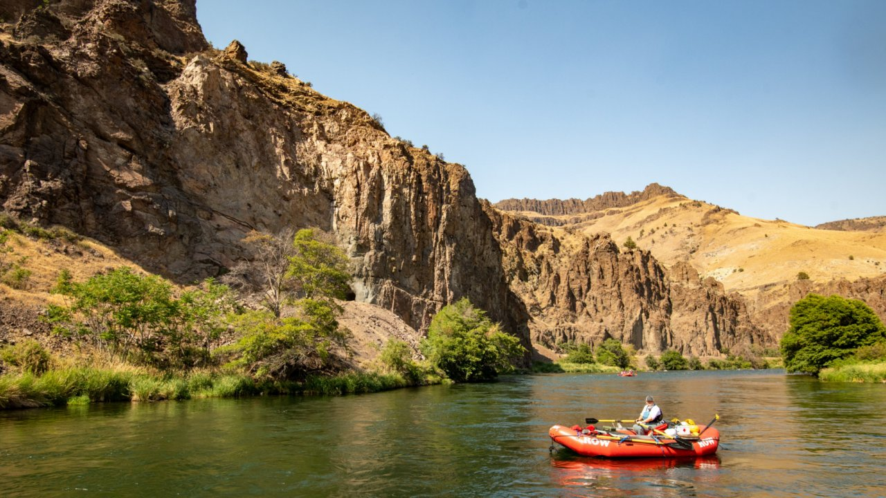red raft floating on the Deschutes river