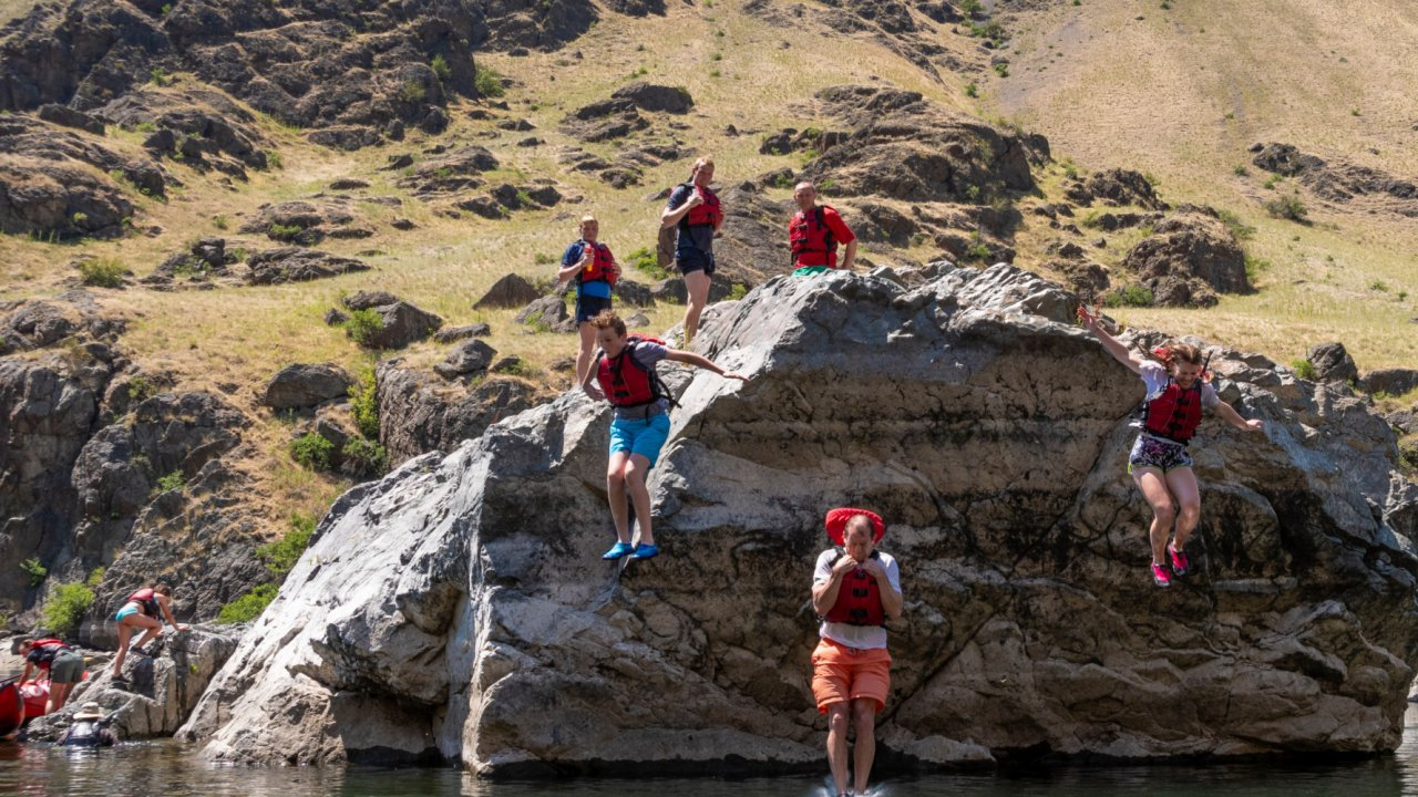 people cliff jumping on snake river, idaho