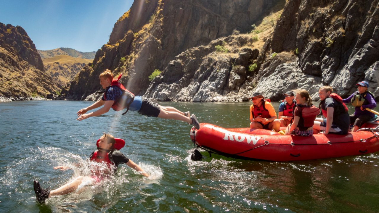 kids jumping in water from rafts