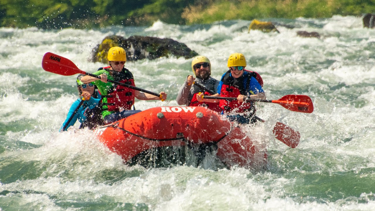 red raft on whitewater rapids deschutes river