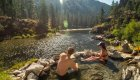 couple sitting in hot spring along the salmon river