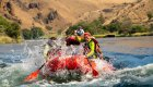 red raft on the deschutes river in oregon