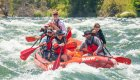 red whitewater raft on rapids