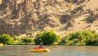 yellow cargo raft on the deschutes river