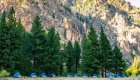 row of blue tents set up in Idaho wilderness