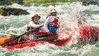 red raft in splashy whitewater