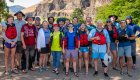group of whitewater rafters in front of deschutes river