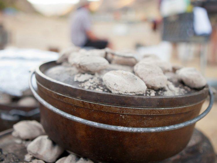 dutch oven toped in coals