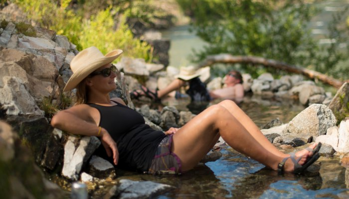 woman soaking in river hotsprings