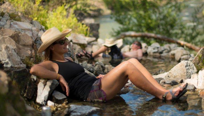 woman soaking in river hotsprings