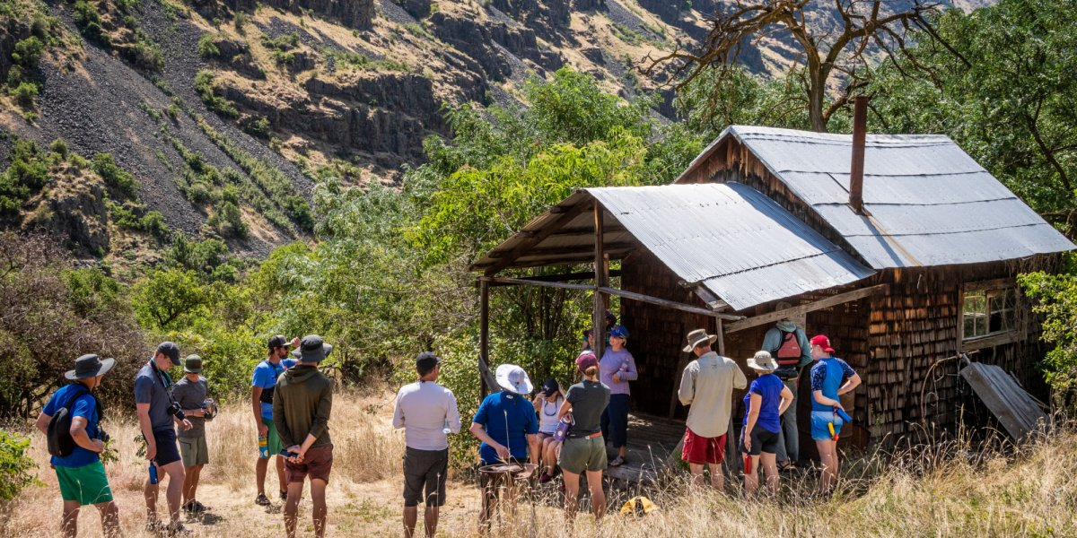 ROW guides lead guests on a tour of a pioneer homestead along the Snake River in Idaho.