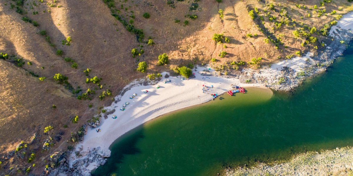 A sandy beach nestled along the shores of the Lower Salmon River Canyons