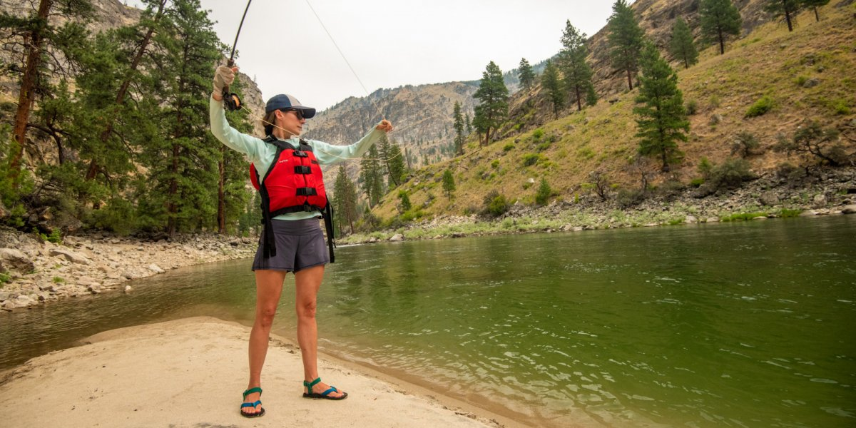 A ROW Adventures guest practices her fly cast during some downtime at camp on the Middle Fork of the Salmon River.